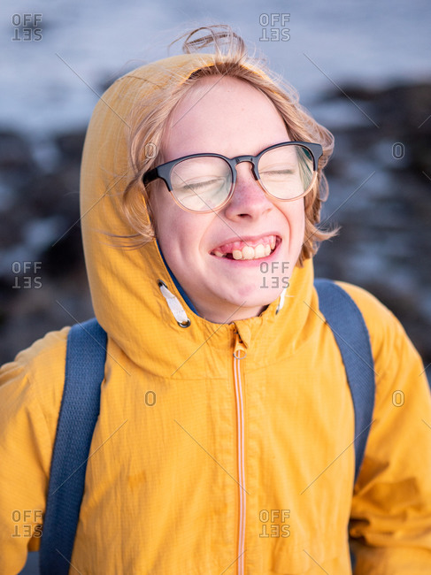Portrait of tween with big smile and eyes closed