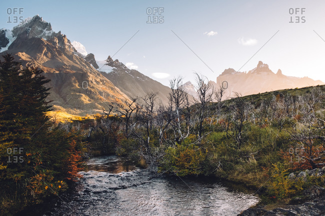 Majestic mountain and river landscape with blue sky
