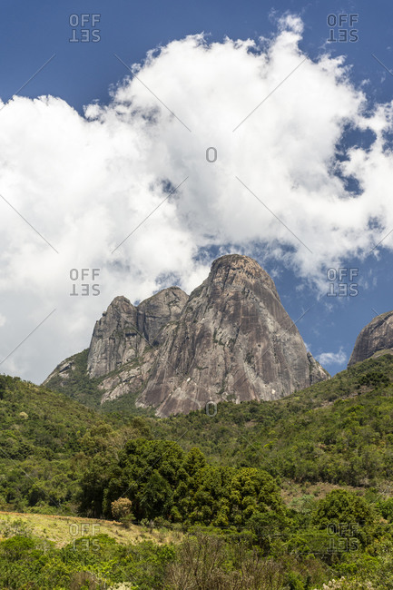 Beautiful landscape of rocky mountain peak with green rainforest