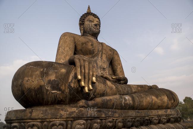 Buddha statue at Wat Mahatat temple , Sukhothai Historical Park, Sukhothai, Thailand.