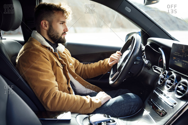 Person driving a high-end car