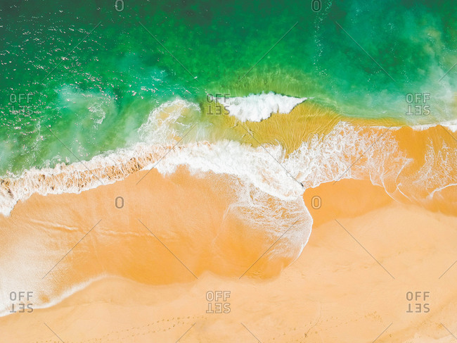 Aerial drone view of beach and ocean tropical turquoise