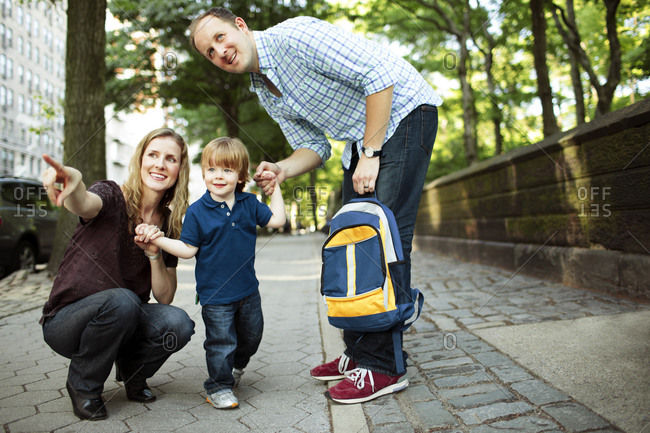Parents walking son to preschool or daycare