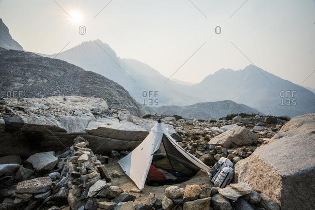 Tent set up on rocky mountainside