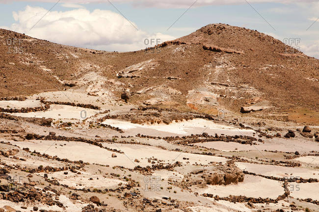 Field terraces above a Berber village in the Anti Atlas mountains of Morocco, North Africa. In recent years, rainfall totals have reduced by around 75% as a result of climate change. This has