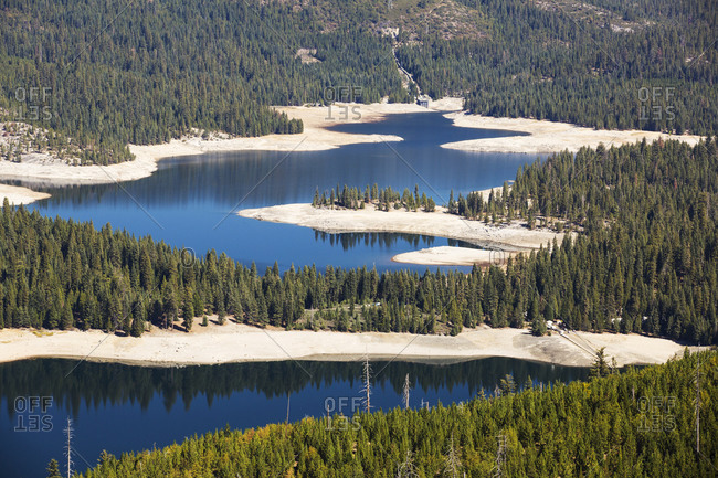 The ice house lake in drought conditions in the El Dorado National Forest, California, USA.