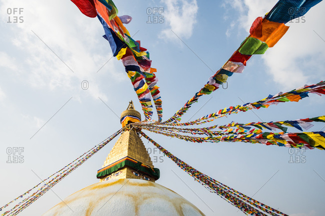 The Buddha Stupa strung with Prayer flags in Kathmandu Nepal