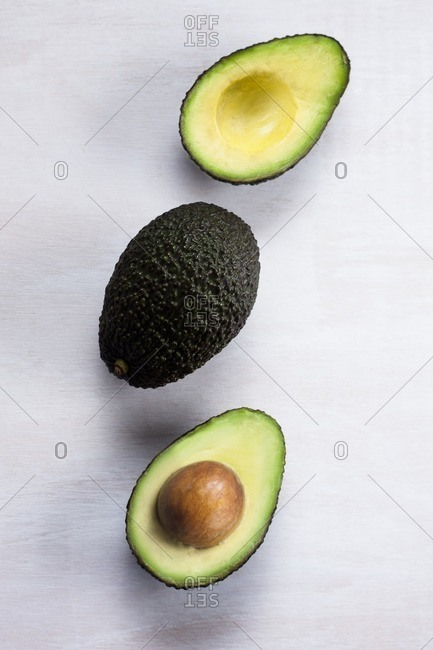 One whole avocado and another cut in half