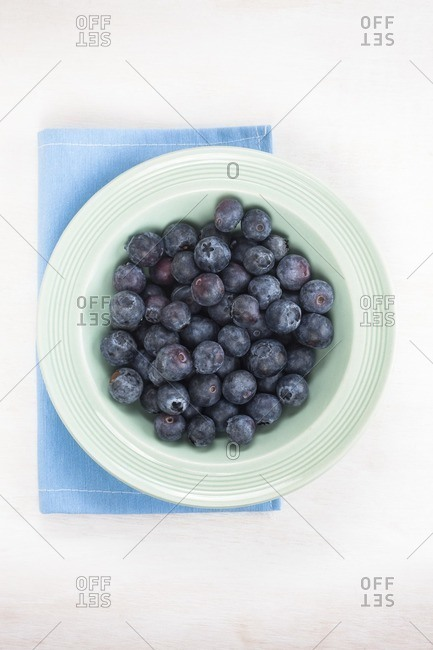 Blueberries in a small bowl, top view