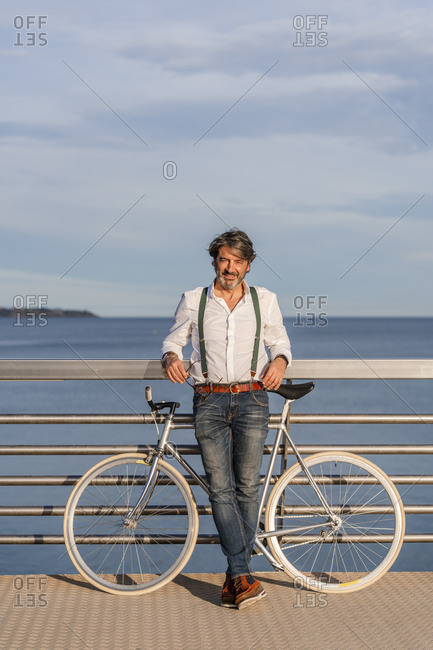Man with fixie on a jetty