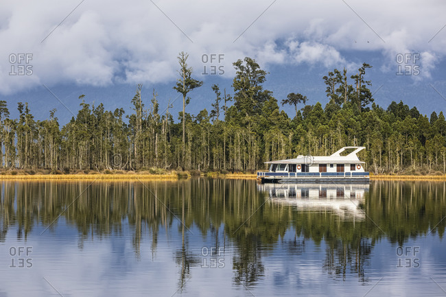 New Zealand- Grey District- Inchbonnie- Recreational boat at Lake Brunner