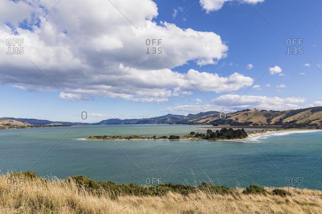 New Zealand- Dunedin- Scenic view of clouds over Taiaroa Head headland