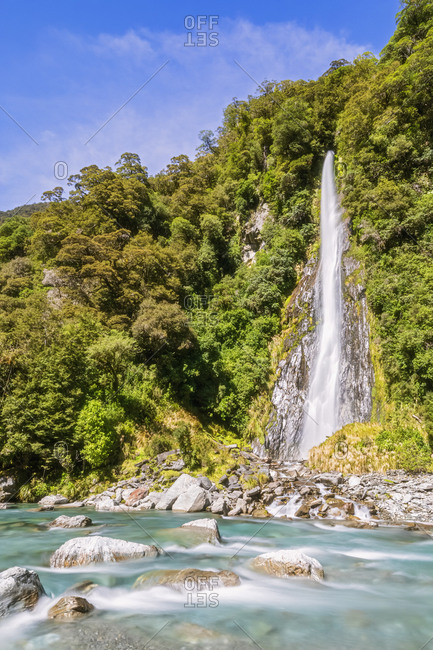 New Zealand- Scenic view of Thunder Creek Falls in Mount Aspiring National Park