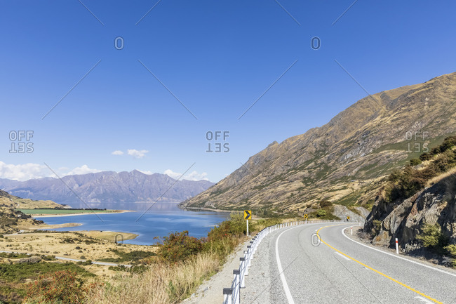 New Zealand- Queenstown-Lakes District- Wanaka- Clear summer sky over empty Makarora-Lake Hawea Road