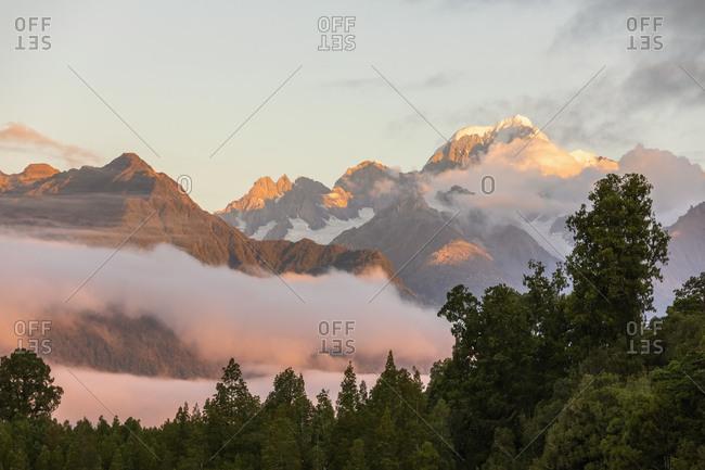 New Zealand- Westland District- Fox Glacier- Mountain range shrouded in morning fog