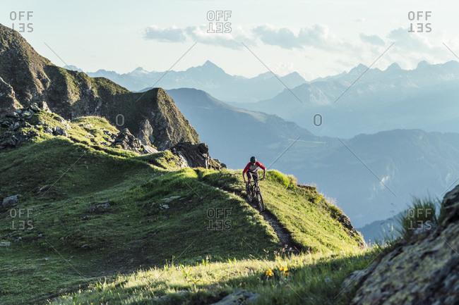 Mountainbiker on a way on a ridge- Grisons- Switzerland
