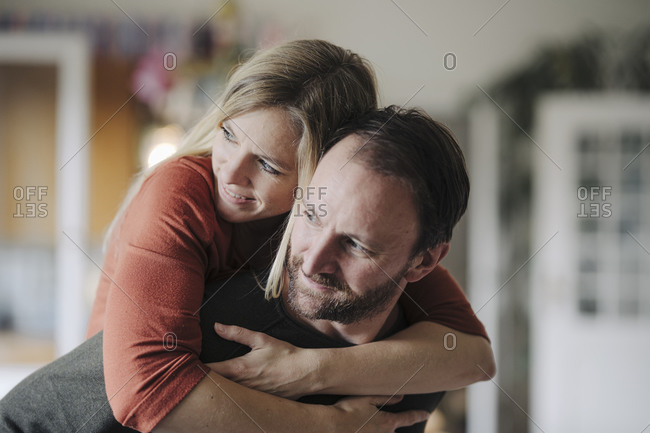 Happy couple embracing in their comfortable home
