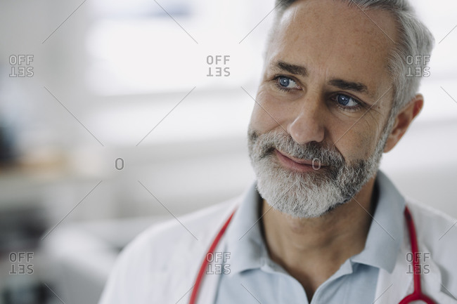 Portrait of blue-eyed mature doctor with stethoscope