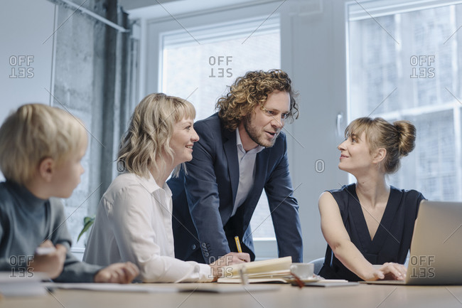 Business team with a boy having a meeting in office