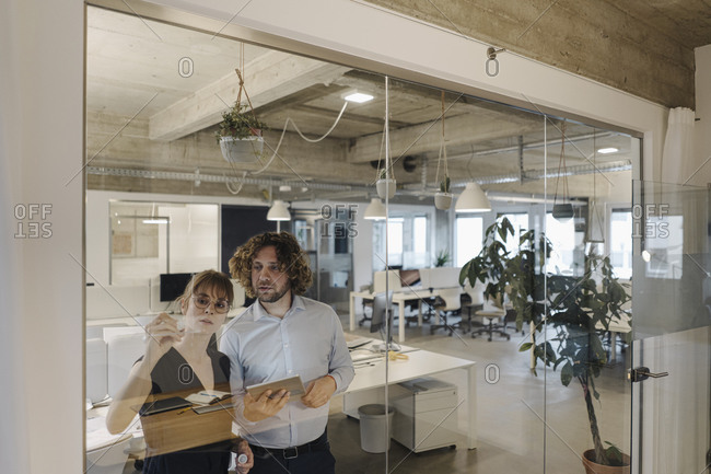Businessman and businesswoman working on a project in office