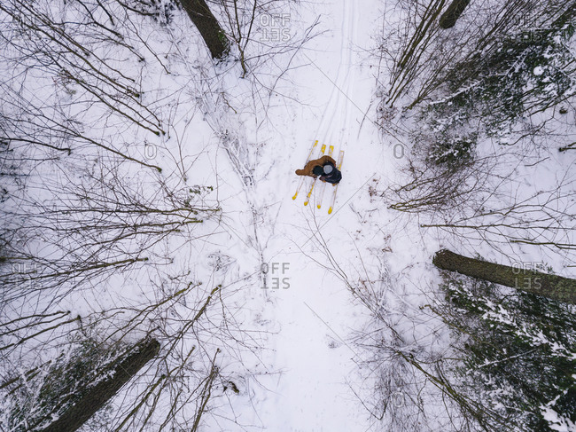 Aerial view of couple with skis in the forest- Leningrad region- Russia