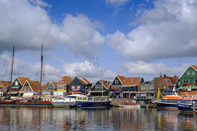 July 9, 2019: Netherlands- North Holland- Volendam- Clouds over boats moored in town harbor