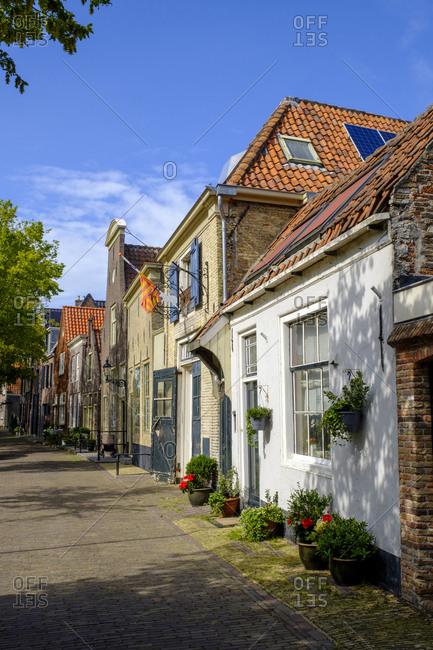 July 9, 2019: Netherlands- North Holland- Enkhuizen- Row of houses along Zuider Havendijk street