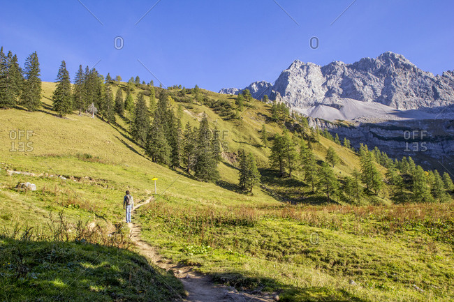 Man hiking the Karwendel mountains in autumn- Hinteriss- Austria