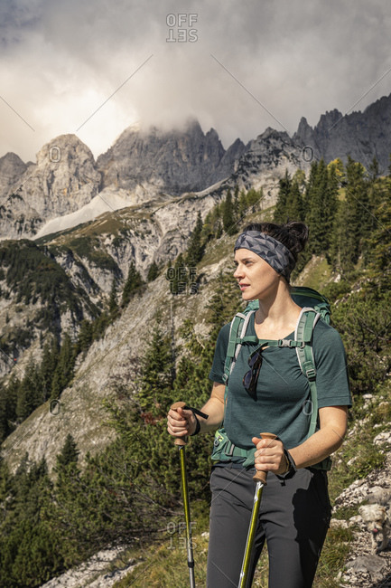 Woman on a hiking trip at Wilder Kaiser enjoying the view- Kaiser mountains- Tyrol- Austria