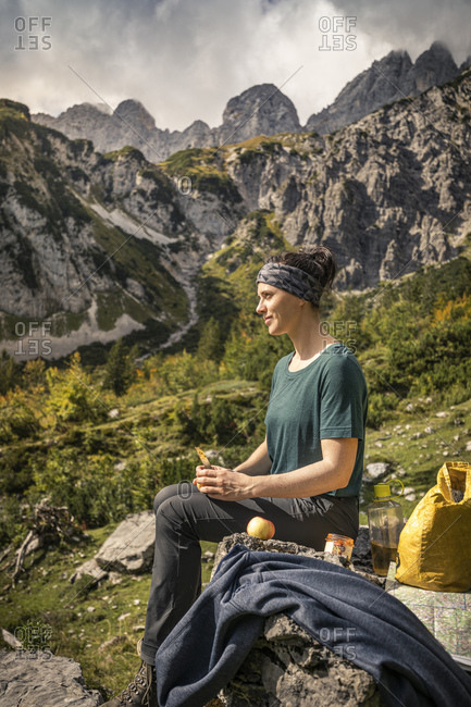 Woman on a hiking trip at Wilder Kaiser having a break- Kaiser mountains- Tyrol- Austria