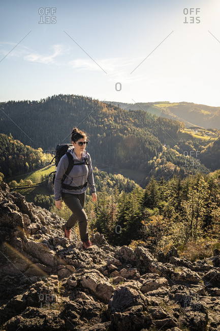 Woman hiking on rocky trail- Karlsruher Grat- Ottenhoefen- Black Forest- Germany