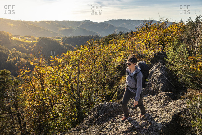 Woman hiking on rocky trail- Karlsruher Grat- Ottenhoefen- Black Forest- Germany