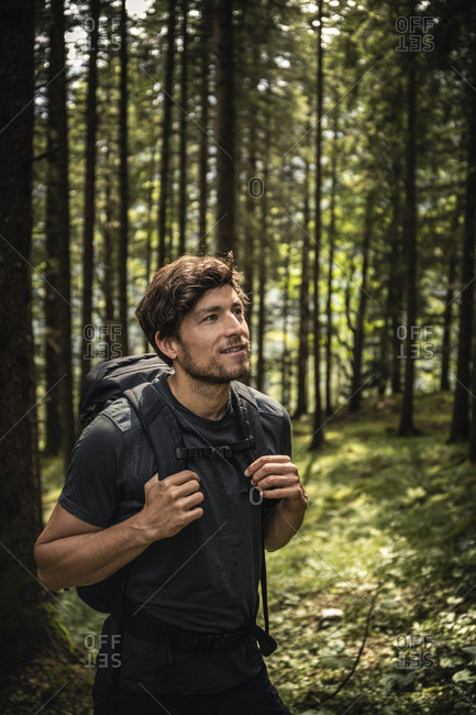 Man with backpack on a hiking trip in forest- Karwendel- Tyrol- Austria