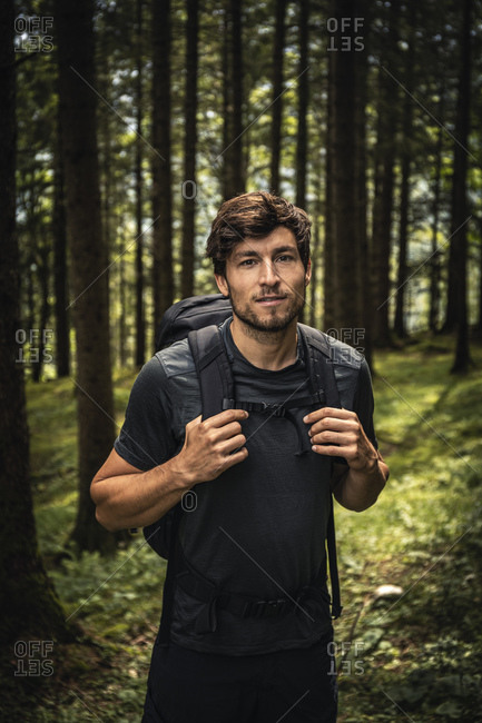 Portrait of a man with backpack on a hiking trip in forest- Karwendel- Tyrol- Austria