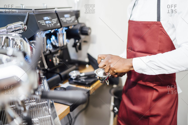 Close-up of barista at work in a coffee shop