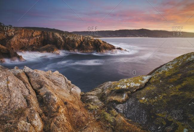 Spain- Province of A Coruna- Ferrol- Long exposure of coastal landscape at dusk