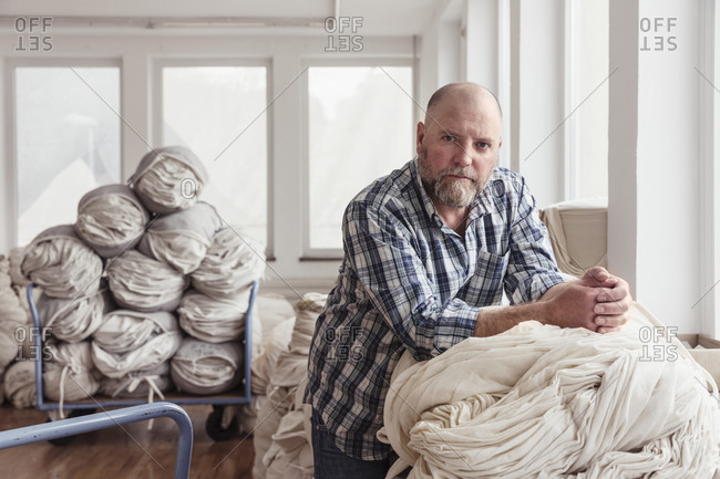 Portrait of a confident mature man in a textile factory