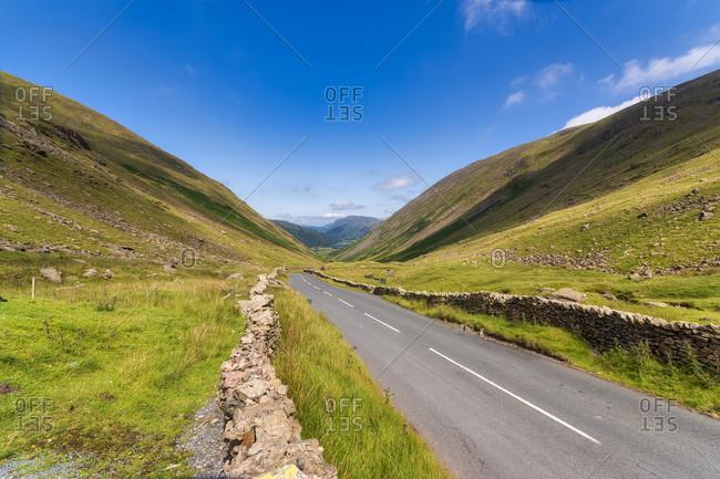 UK- England- Empty highway of Kirkstone Pass in summer