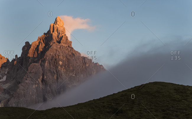 Cimon de la Pala wrapped by clouds during summer sunset, dolomites, Trentino Alto Adige, Italy, Europe