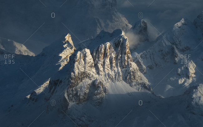 Detail of the Averau and Nuvolau mountains illuminated by the sun after a heavy snowfall, View from the Lagazuoi refuge, dolomites, Cortina d'Ampezzo, Veneto