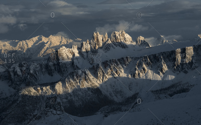 Overview of the Croda da Lago and Lastoi de Formin mountains illuminated by the sun after a heavy snowfall, view from the Lagazuoi refuge, Falzarego, Cortina d'Ampezzo, dolomites, Italy, Europpe