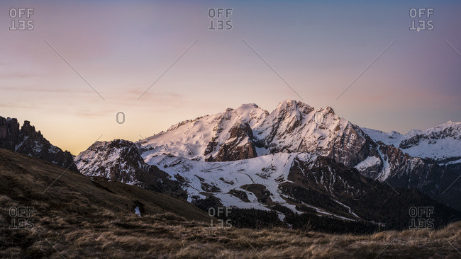 Overview of the Marmolada at dawn, view from near the Sella pass, Trentino Alto Adige