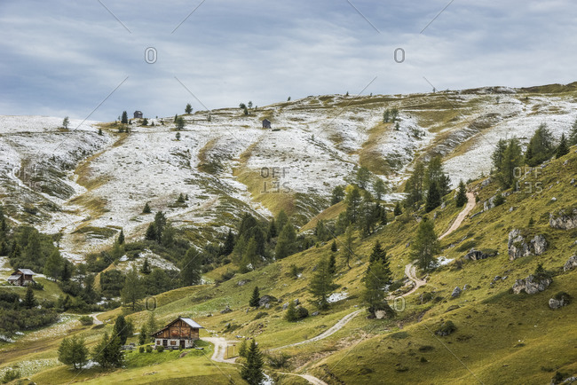 Meadows of the Giau pass partly covered by a dusting of snow, dolomites, Cortina d'Ampezzo, Veneto, Italy