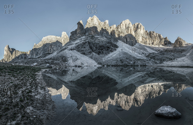 Pale di San Martino reflected in the Pradidali lake at the first light of day, dolomites, Trentino Alto Adige, Italy, Europe