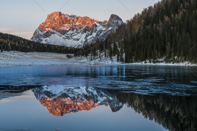 Pale di San Martino at sunset during the enrosadira reflected in the Calaita lake, dolomites, Trentino Alto Adige, Italy, Europe