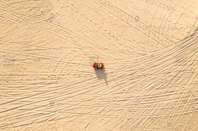 October 13, 2018: Aerial view of a quad bike on the sand, Taiba, Sao Goncalo do Amarante, Ceara, Brazil
