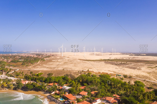 October 19, 2018: Aerial view of the beach shore with windmills in the background, Taiba, Sao Goncalo do Amarante, Ceara, Brazil