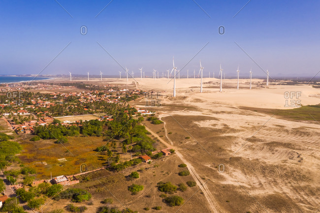Aerial view of the beach shore with windmills in the background, Taiba, Sao Goncalo do Amarante, Ceara, Brazil