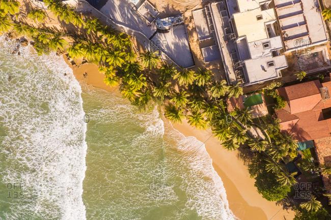 Aerial view of houses on the shore of the beach, Taiba, Sao Goncalo do Amarante, Ceara, Brazil