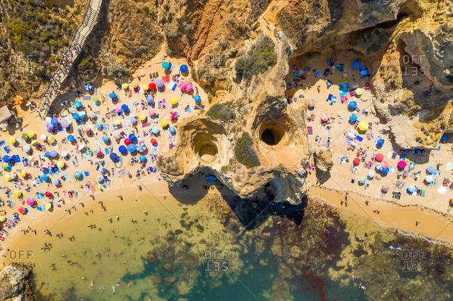Aerial view of the beach shore in Praia do Camilo, Lagos, Portugal